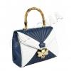 Чанта с наподобяваща бамбук дръжка
